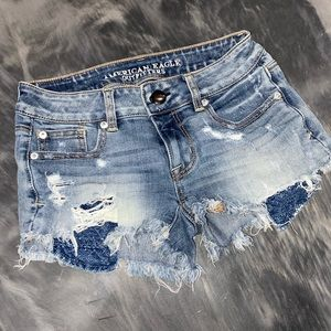 AMERICAN EAGLE SUPER STRETCH SHORTIE JEAN SHORTS